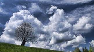 Promjenljivo oblačno uz povremenu kišu